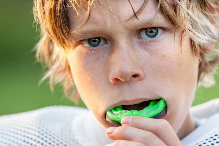 Boy Wearing Mouth Guard in Dubai