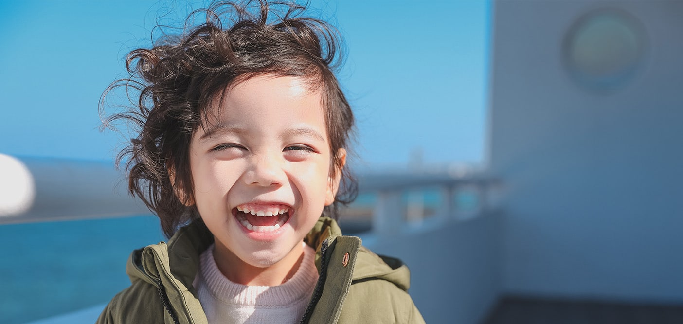 Cute child with curly hair smiling