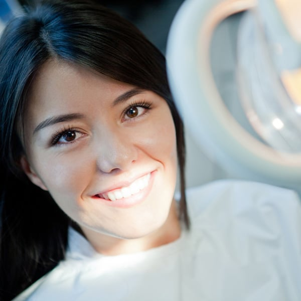 Patient in Dental Chair Smiling