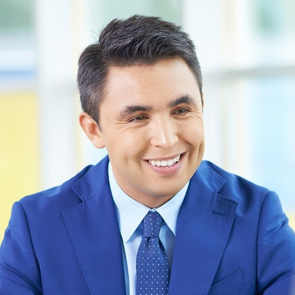 man smiling and looking away from the camera
